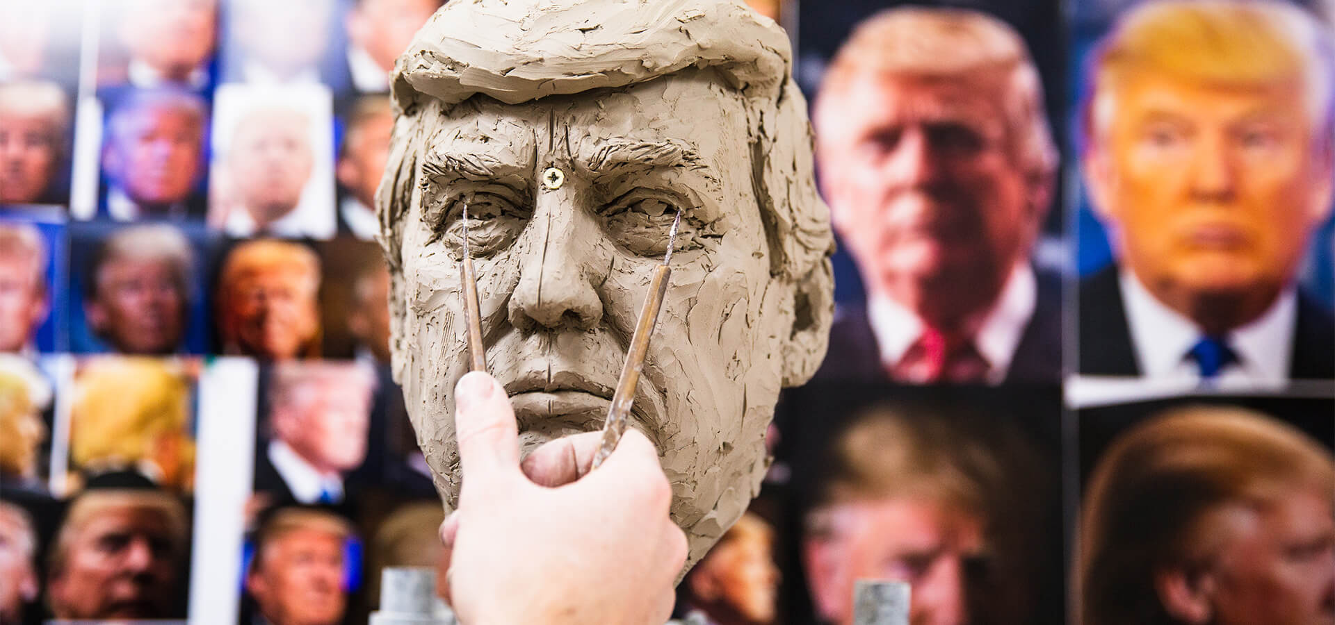 A slide depicting the process of sculpting the Donald Trump's head in clay prior to being cast in wax.