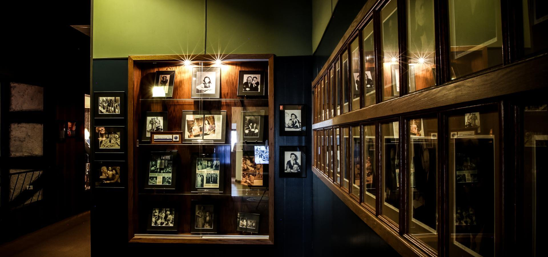 The photo gallery exhibit within The National Presidential Wax Museum depicting the lives of American Presidents as well as their families, pets and acquaintances.