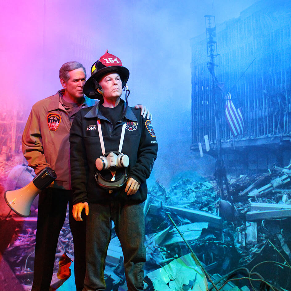 George W. Bush and First Responder at 9-11 site.
